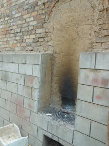 The kiln walled off with only a whole to put the charcoal and wood in