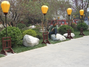 I think this is a random worker or a man tired of touring around china, either way He almost blended in to the scenery..