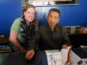 They talked me into buying the book, and with it I got a picture.  and signiture.  This is the guy who was drilling the particular well where the peices of teracotta and brozne were found and handed to the government  leading to the finding of the Terracotta warriors!