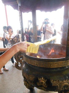 Tradition in religion of the Taiwanese is to write your own Wish on the yellow paper and you burn it, to sent it to the Gods! Hope my wish comes true!